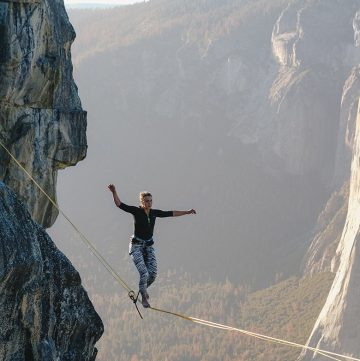 Anxiety - woman walking on tightrope.