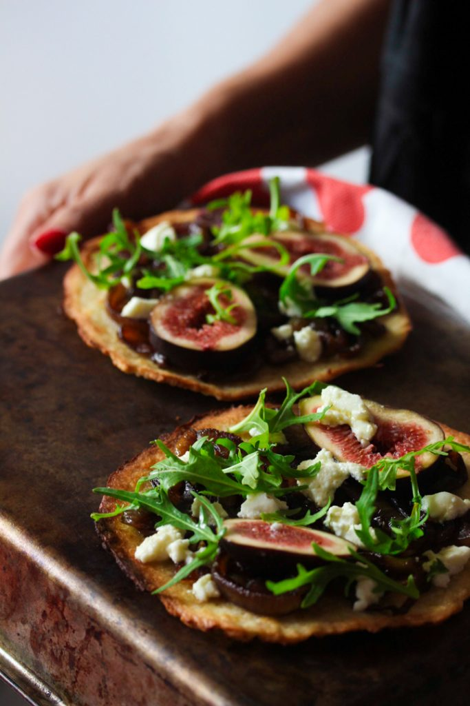 Thin and Crispy Pizzas topped with fig, caramelised onion, arugula and goat cheese