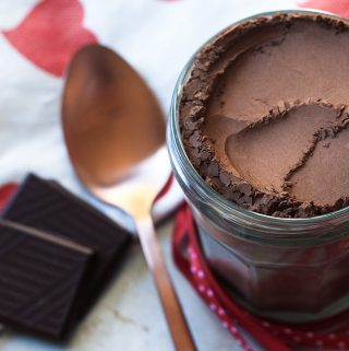 Luxe hot chocolate mix in a jar with serving spoon.