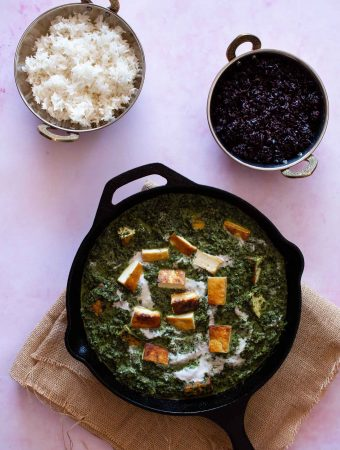 Dairy free Palak Paneer served in a cast iron pan with black rice and white rice