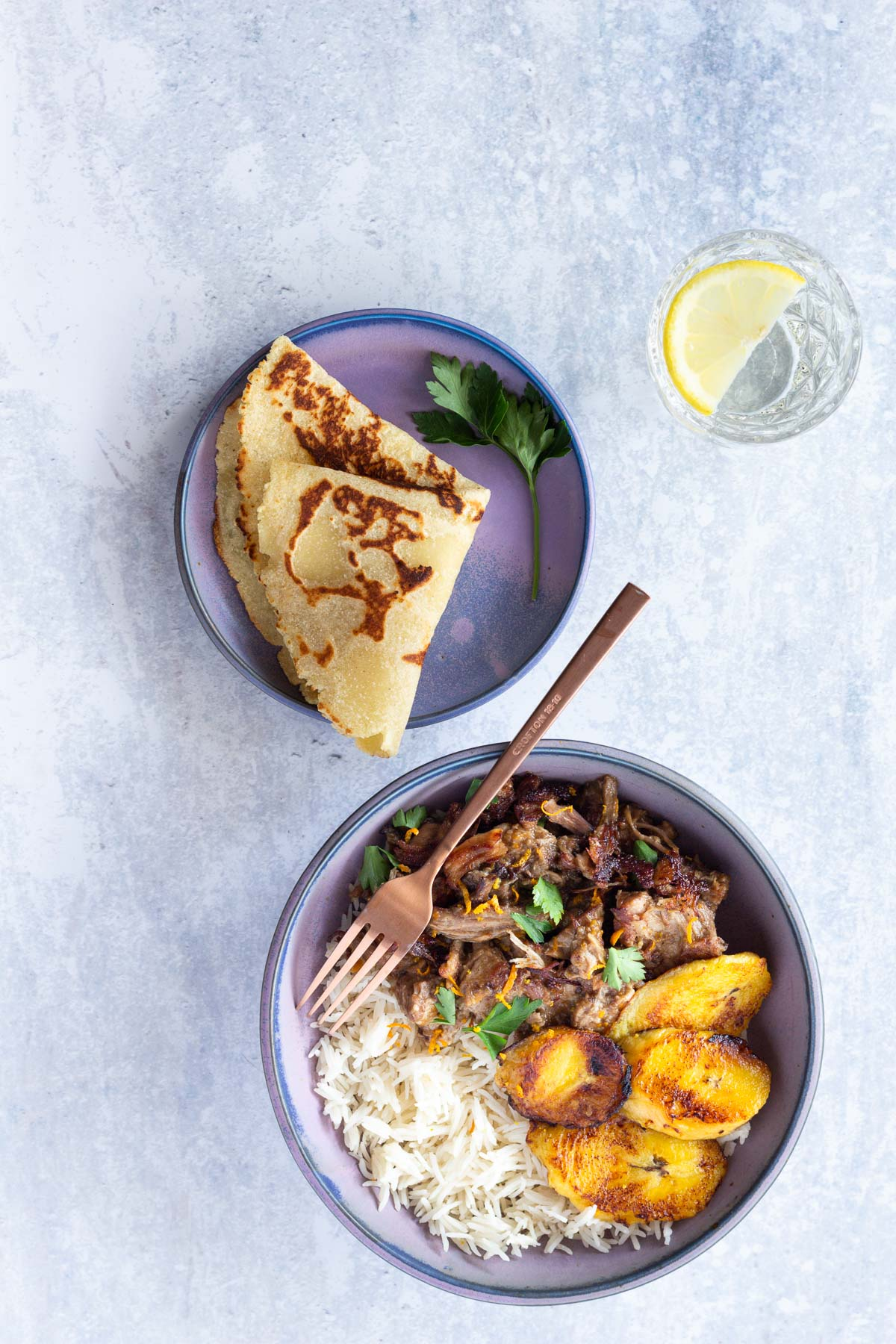Top down photo of Crispy Carnitas with Cinnamon, Garlic and Orange Sauce (Pulled Pork) served with white rice
