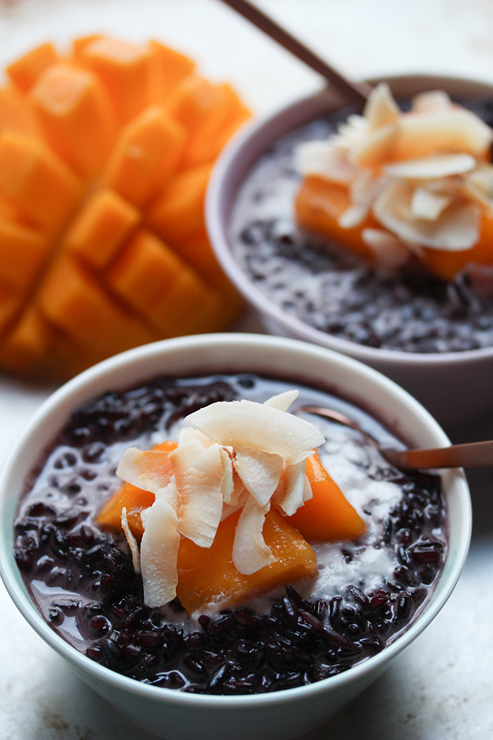 Close up shot of Black Rice Pudding with Mango and Coconut Flakes