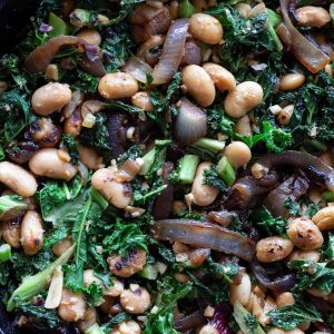 Butter Beans close up image - with caramelised onion, kale and preserved lemon