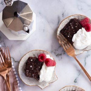 Miracle Flourless Brownies served with coffee, cream and raspberries