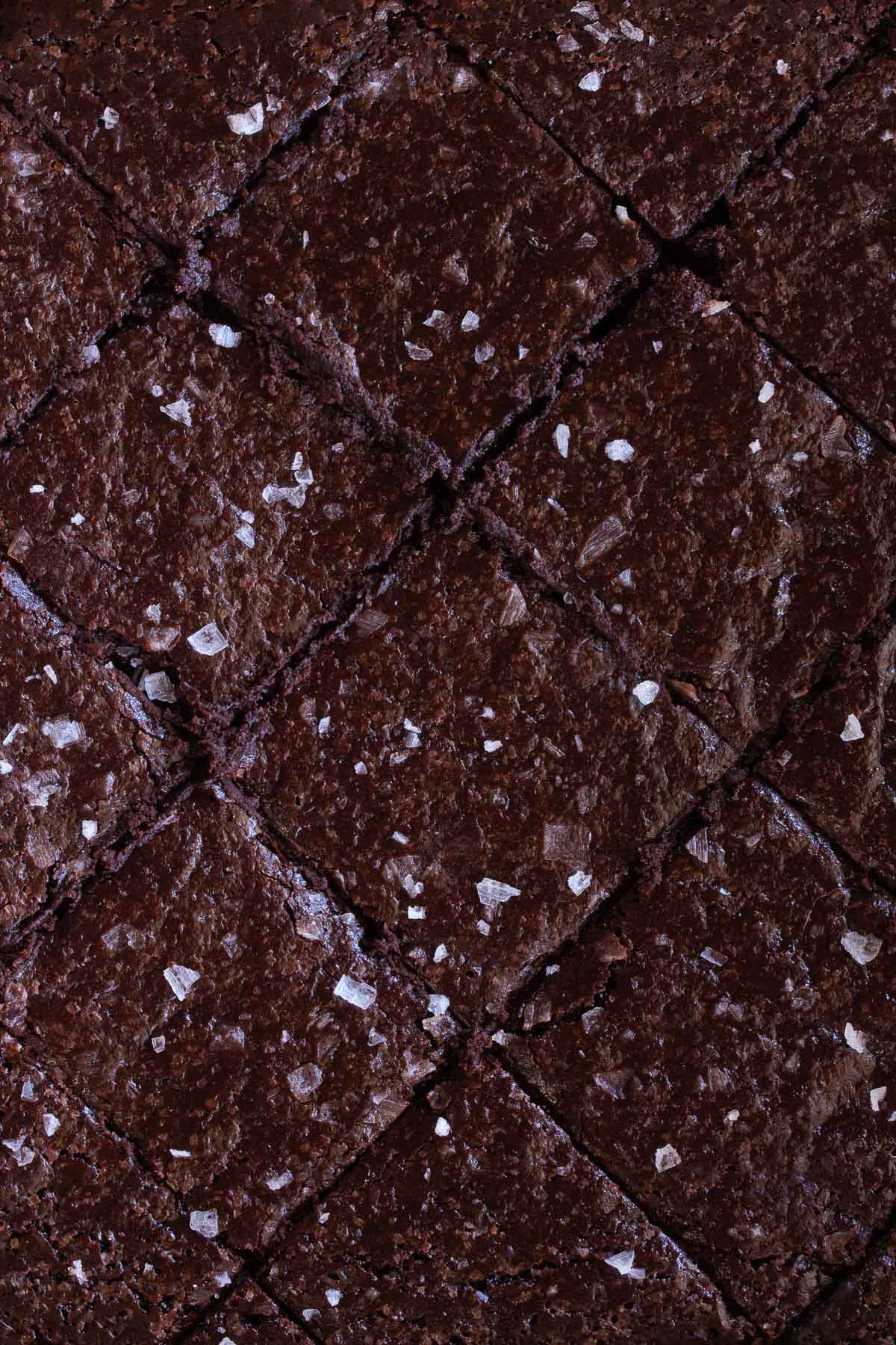 Close up photo of Miracle Flourless Brownies sprinkled with sea salt