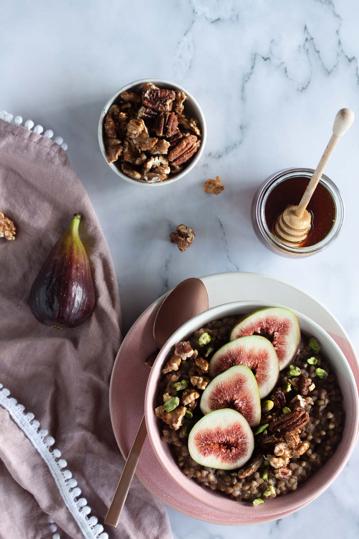 Flatlay image of Baklava Buckwheat Porridge served with figs, candied nuts and honey