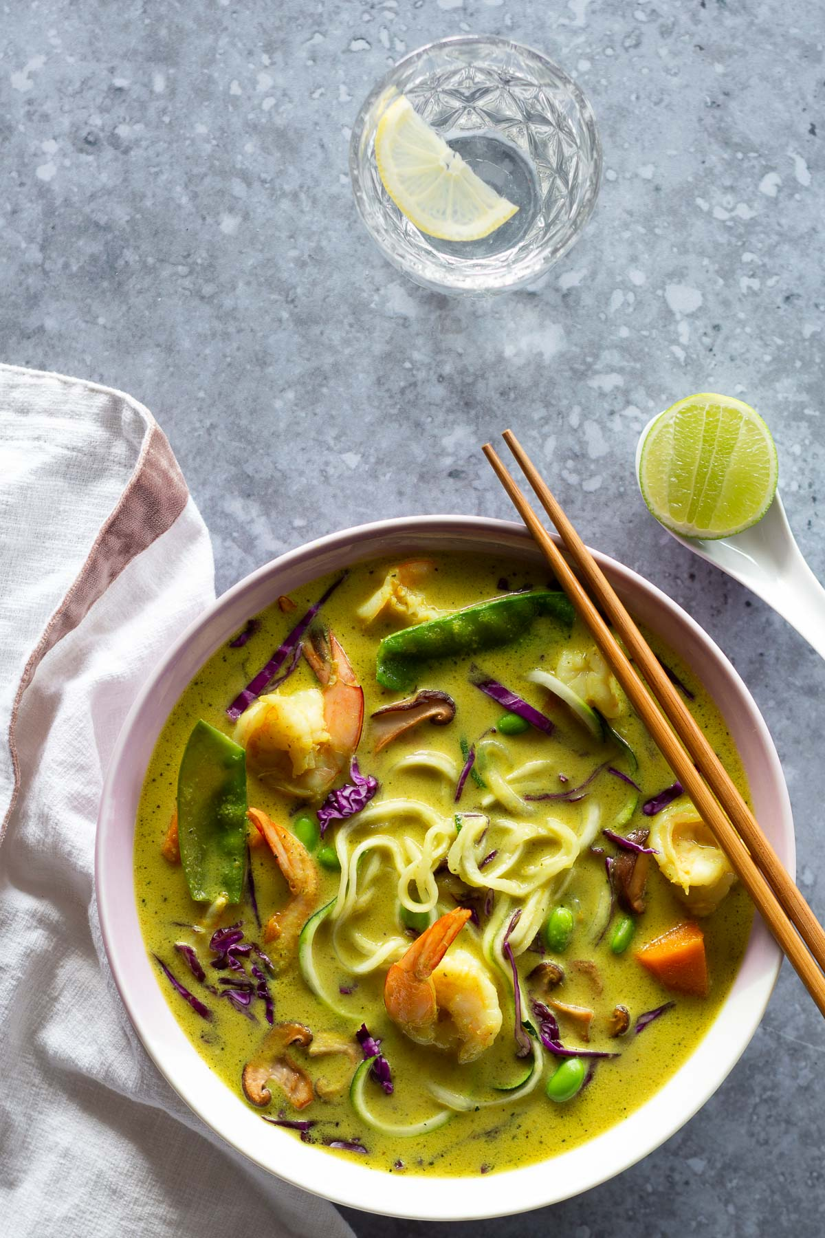 Lemongrass noodle soup packed with tasty veggies, noodles and served with a lime cheek