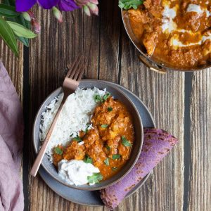 Dairy Free Butter Chicken served with purple flatbread and fluffy rice