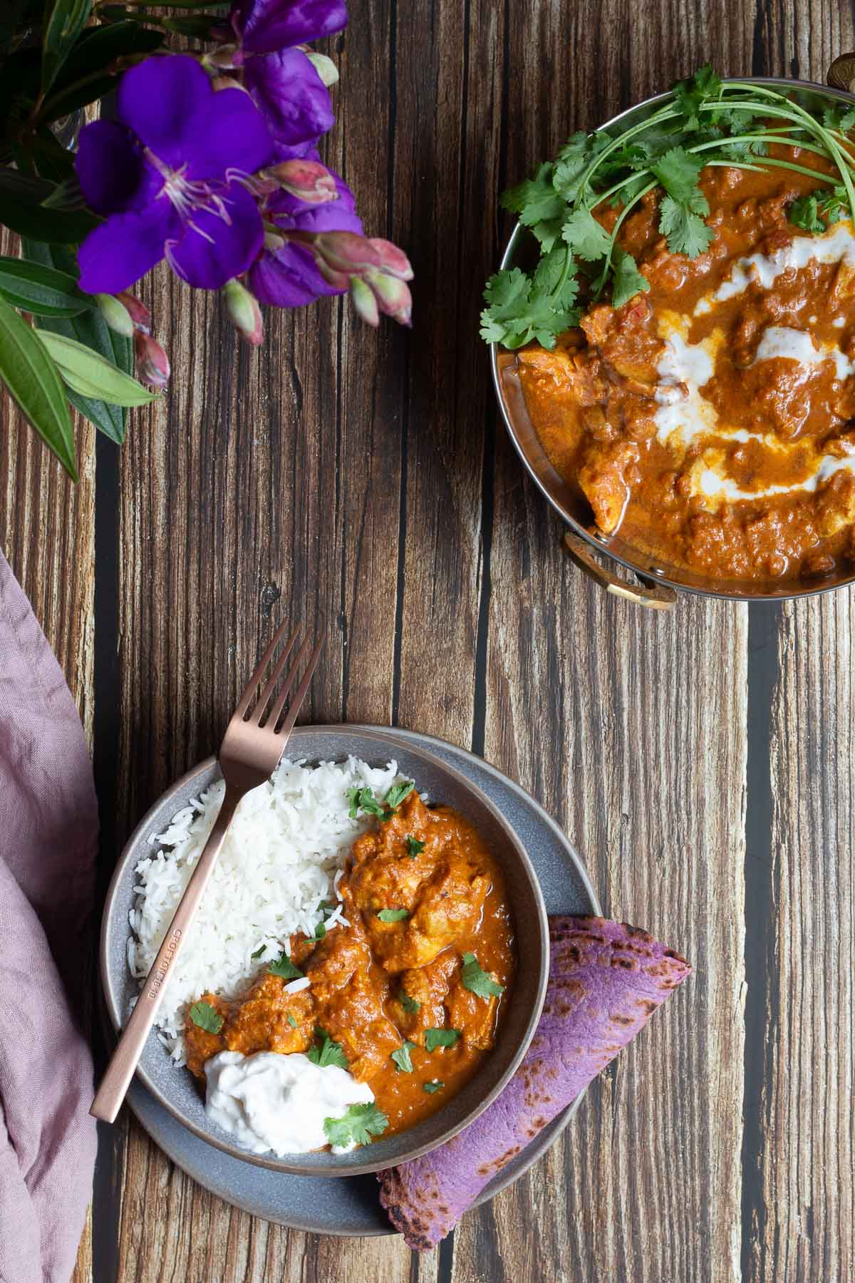 Dairy Free Butter Chicken served with purple flatbread and fluffy basmati rice