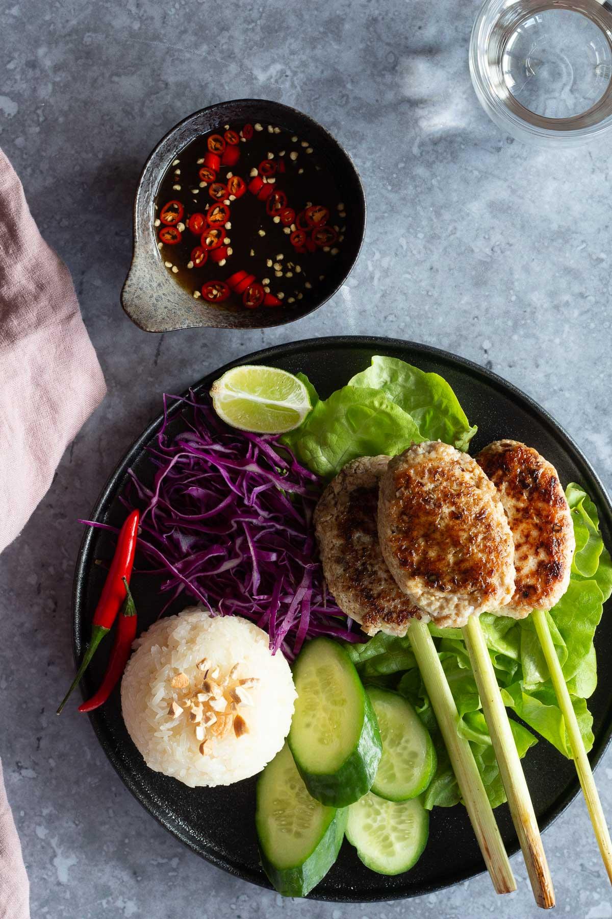 Lemongrass Pork Skewer with dipping sauce and fresh veggies